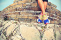Woman runner legs sit on great wall Royalty Free Stock Photo