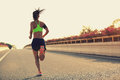 Woman runner running on city bridge road
