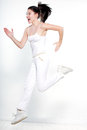 Woman runner running jumping happy one beautiful young caucasian on studio white background Stock Images