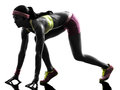 Woman runner running on starting blocks silhouette Royalty Free Stock Photo