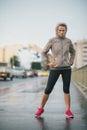 Woman runner wearing rain gear feeling determined