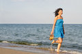Woman running along the edge of the surf Stock Photography