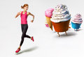 Woman running away from sweets Royalty Free Stock Photo