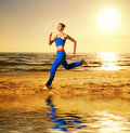 Woman running on a beach Royalty Free Stock Photo