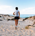 Woman running on beach athletic asian runner jogging outdoors a Stock Images
