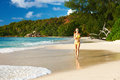 Woman running at beach in bikini tropical seychelles Royalty Free Stock Images