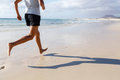Woman running on beach fit asian runner jogging barefoot Royalty Free Stock Photos