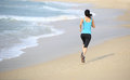 Woman running at beach sporty young fit asian Stock Photos