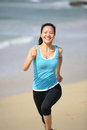 Woman running at beach young fit asian Royalty Free Stock Image