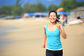 Woman running beach young fit asian seaside Royalty Free Stock Photo
