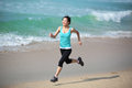 Woman running at beach young sports asian seaside Stock Photo