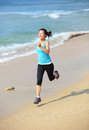 Woman running at beach young sports asian seaside Stock Image