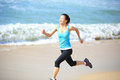 Woman running at beach young sports asian seaside Royalty Free Stock Photos