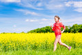 Woman running for better fitness in spring happy Royalty Free Stock Photos