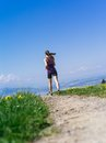Woman running on a country path photo of young jogging and exercising lake in the distance Royalty Free Stock Images