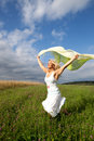Woman is running on a green meadow Royalty Free Stock Photo