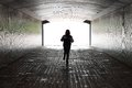 Woman Running Inside a Tunnel Royalty Free Stock Photo