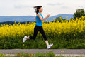 Woman running, jumping Royalty Free Stock Photography
