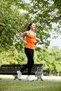 Woman running outdoors Royalty Free Stock Photos