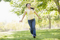Woman running outdoors smiling Stock Photography
