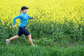 Woman running outdoors on spring Stock Photo
