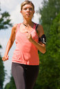 Woman running in the park. Royalty Free Stock Photos