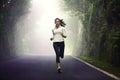 Woman running on road female runner jogging mountain training for marathon fit girl fitness athlete model exercising Stock Images