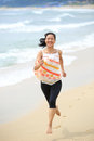 Woman running seaside young happy Stock Images