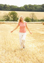 Woman Running Through Summer Harvested Field Royalty Free Stock Photo
