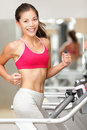 Woman running on treadmill Royalty Free Stock Photos