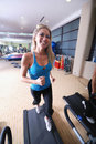 Woman running on treadmill Stock Photos