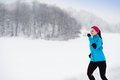 Woman running in winter athlete is during cold snow weather Stock Images