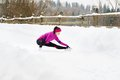 Woman running in winter athlete is during training outside cold snow weather Royalty Free Stock Image