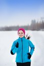 Woman running in winter athlete is during training outside cold snow weather Stock Images