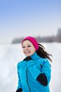 Woman running in winter athlete is during training outside cold snow weather Royalty Free Stock Photography