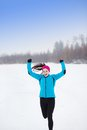 Woman running in winter athlete is during training outside cold snow weather Stock Photos
