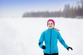 Woman running in winter athlete is during training outside cold snow weather Royalty Free Stock Photo