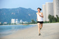 Woman running young fit asian seaside Royalty Free Stock Photography