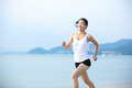 Woman running young fit asian seaside Stock Photography