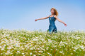 Woman runs in the field of camomiles Royalty Free Stock Images
