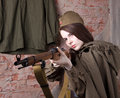 Woman in Russian military uniform shoots a rifle. Female soldier during the second world war. Royalty Free Stock Photo