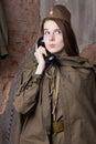 Elderly woman speaks on the phone