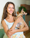 Woman with russian toy in arms portrait of happy smiling young at home Royalty Free Stock Photo