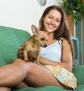 Woman with russian toy in arms positive cheerful young at home Royalty Free Stock Image