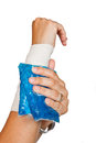 Woman s arm with bandage and ice painkiller a Royalty Free Stock Photos