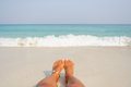 Woman's Bare Feet on the beach. Royalty Free Stock Photo