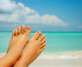Woman's Bare Feet over Sea background Royalty Free Stock Photos