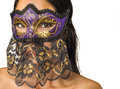 Woman s face concealed venetian mask by isolated against white background Stock Photography