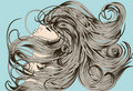 Woman's face flipping detailed hair Royalty Free Stock Photography