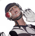 Woman's face in helmet being hit by cricket ball Royalty Free Stock Photo
